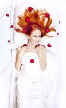 Free Beautiful Red-haired Girl In Bed With Rose Petal. Stock Photos - 17092293