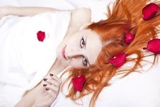 Free Beautiful Red-haired Girl In Bed With Rose Petal. Royalty Free Stock Images - 17092329