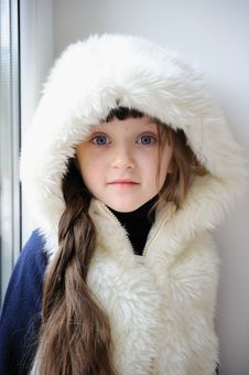 Free Adorable Small Girl In White Fur Hood Stock Photography - 17092942