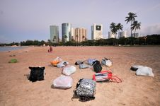 Free Many Bags On A Sandy Beach With Buildings Royalty Free Stock Photo - 17093035