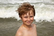 Cute Boy Enyoys The Water In The Ocean Royalty Free Stock Images