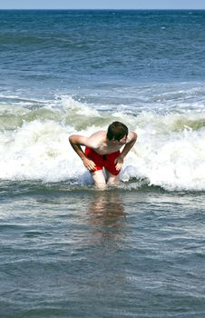 Free Young Boy Is Body Surfing In The Waves Royalty Free Stock Image - 17094906