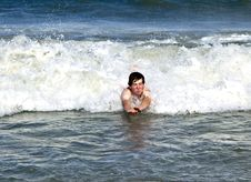 Free Young Boy Is Body Surfing In The Waves Royalty Free Stock Image - 17095036
