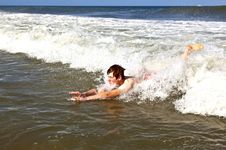 Free Young Boy Is Body Surfing In The Waves Stock Image - 17095071