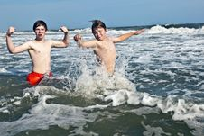 Boys Enjoying The Beautiful Ocean And Beach Stock Photo