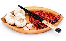 Chop Sticks, Chili Fruit And Garlic Royalty Free Stock Photo