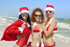 Three Happy Santa Clause Having Fun Stock Photos