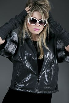 Woman With Sunglasses And Leather Jacket Stock Photos