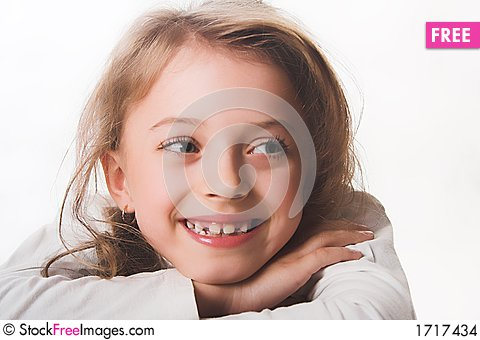 A beautiful blue-eyed, blond child dressed in white. Stock Photo