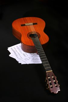 Free Acoustic Guitar With Music Sheets Royalty Free Stock Photos - 1712288