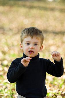 A Little Boy Eating Short Stick Royalty Free Stock Photos
