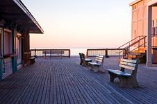 Sunrise On An Empty Boardwalk-2 Stock Photos