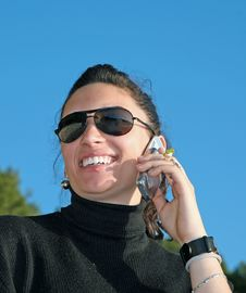 Girl Talking By Cell Phone Stock Photography