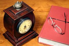 Clock, Book And Glasses On Desktop Royalty Free Stock Photos