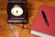 Clock And Book On Desk Stock Photography