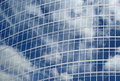 Free Reflection Of A Cloudy Sky In Glass Wall Stock Photography - 17101932