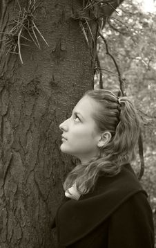 Innocent Girl Looks At Dangerous Needles On A Tree