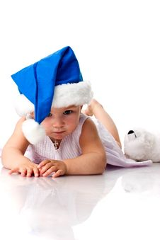 Free Baby Lying In Santa S Blue Hat Royalty Free Stock Photography - 17102347