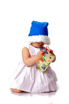 Free Beautiful Baby In Santa S Hat With A Present Royalty Free Stock Photos - 17102388