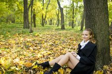 Teen Girl Sits Under The Tree Leaves In Park Royalty Free Stock Images