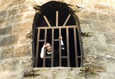 Teen Girl Looks Out Of The Jail Window Stock Image