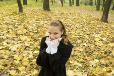 Free Teen Girl Warms Herself In Cold Autumn Park Stock Images - 17102894