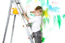 Cute Boy Paiting Over White Stock Images