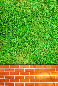 Brick Wall Fence And Grass Field Stock Image