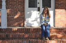 Free Pretty Teen Girl Sits On Front Steps Royalty Free Stock Photos - 17109418