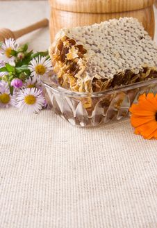 Free Honey, Honeycomb In Pot, Stick And Flowers On Sack Stock Images - 17109734