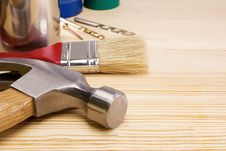 Hammer, Paintbrush And Other Instruments On Wood Stock Photography