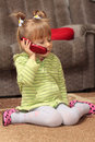 Free Charming Little Girl Talking On The Phone Stock Photos - 17112823