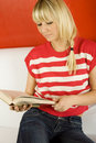 Free Women Reading A Book On Sofa Stock Photo - 17115540