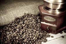 Coffee Beans And Grinder On Sacking In Night Stock Photo