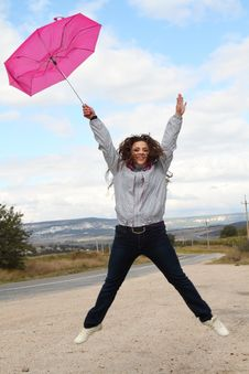 Free Jumping Happy Lady With  Umbrella Royalty Free Stock Photos - 17112358