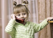 Free Charming Little Girl Talking On The Phone Royalty Free Stock Images - 17112819