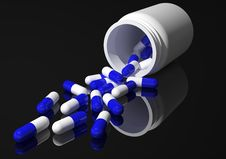 Capsules Fallen Out Of Jar Royalty Free Stock Photo