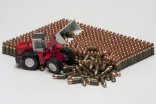 Free Pattern Of Pistol Cartridges With Toy Bulldozer Stock Images - 17117804