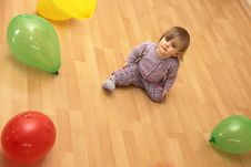 Free Child Sits In The Middle Of Many Colorful Balloons Stock Image - 17122611