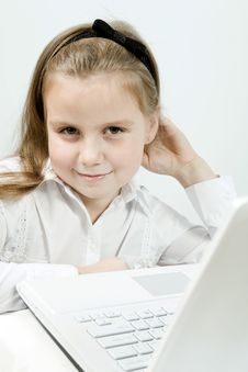 Free Cute Girl With Laptop Indoors Royalty Free Stock Photography - 17124027