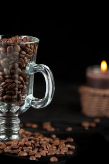 Coffee Beans And Burning Candle Royalty Free Stock Image