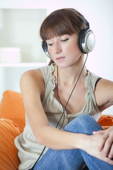 Free Woman With Earphones Hearing Music Royalty Free Stock Image - 17129196