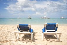 Free Blue Chairs Overlooking Tropical Ocean Royalty Free Stock Photo - 17129595