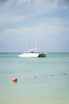 Free Catamaran Sailboat Anchored Off Shore Royalty Free Stock Image - 17129646