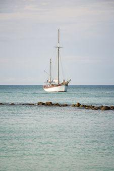 Free Sailboat Anchored Off Shore Royalty Free Stock Photos - 17129708