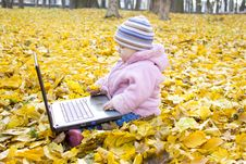 Free Little Girl With A Laptop Royalty Free Stock Photography - 17136187