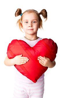 Beautiful Girl With Heart Shaped Pillow Stock Photos