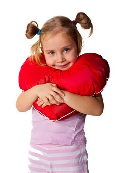 Beautiful Girl With Heart Shaped Pillow Stock Images