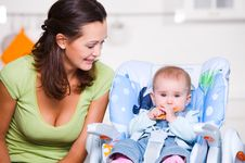 Free Mother Looking On  Baby In The Highchair Stock Image - 17139641