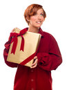 Free Pretty Girl Biting Lip Holding Wrapped Gift Royalty Free Stock Image - 17144666